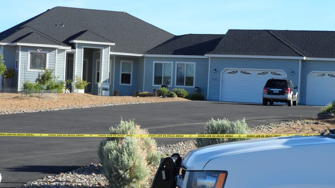 Officials have taped off the property on Leo Bingo Court in Washoe Valley where two people were found dead and one injured Friday night. The suspect was later killed in a shoot-out with Carson City Sheriff's officers at the Sand Mountain Recreation Area.