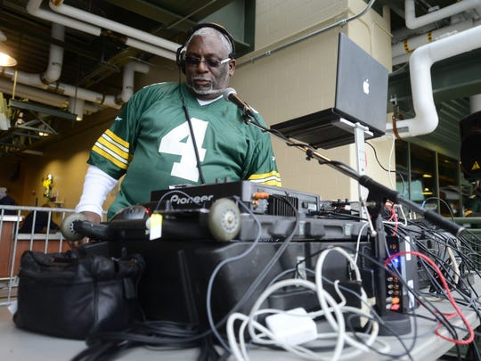 Milwaukee DJ Doc B runs the music for the players' pregame warmups at Lambeau Field. The music — suggested by the players — leans heavily toward rap.
