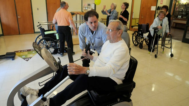Bill Williams, rehabilitation director at the The Baptist Home, a senior living center in Rhinebeck, works with Gerald Weaver in the physical rehabilitation room.
