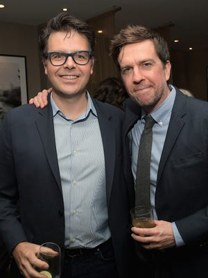 "Screenwriter Phil Johnston, left, poses with actor Ed Helms at a reception to honor the ""Zootopia"" screenwriters (Johnston and Jared Bush) in January."
