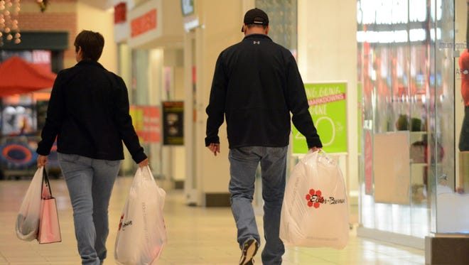 People shop at River Valley Mall Friday morning, Nov. 24, 2017, in Lancaster.