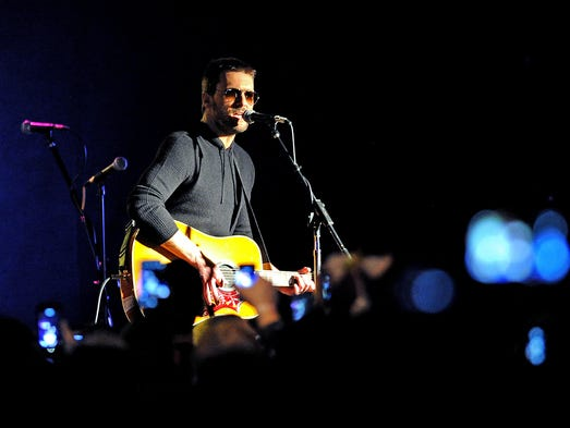 "Country music artist Eric Church performs at 8 Seconds Saloon, Thursday, February 13, 2014, in Indianapolis. Church quickly organized a barnstorming show to promote his new album ""The Outsiders"" with shows in Chicago and Cleveland after the Indianapolis show."