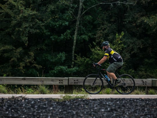 September 13, 2017 - A cyclist rides his bike along