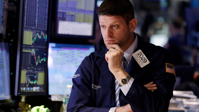 Specialist Michael Gallucci works on the floor of the New York Stock Exchange.