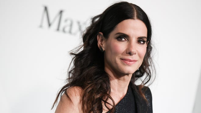 Sandra Bullock may have been named People Magazine's Most Beautiful Woman, but she says she's not exempt from the onslaught of media criticism that women in Hollywood face.