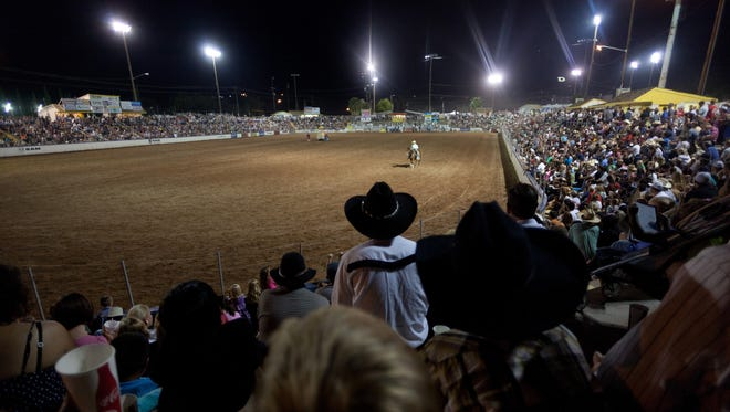 Spectators watch the 2012 Dixie Round-Up Rodeo at the SunBowl in St. George.