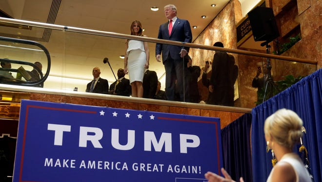 Donald Trump, accompanied by his wife, Melania, is applauded by daughter Ivanka Trump as he's introduced before his announcement that he will run for president in the lobby of Trump Tower on June 16, 2015.