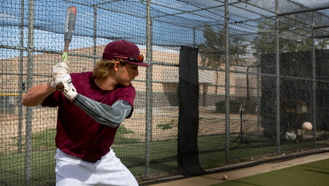 Hamilton High School first baseman Nick Brueser completes batting practice in Chandler, Ariz. on Feb. 17, 2017. Brueser was named Arizona Player of the Year after his team won the state championships last year.