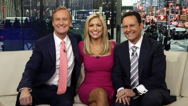 "Steve Doocy, from left, Ainsley Earhardt and  Brian Kilmeade appear on a broadcast of ""Fox & Friends"" in New York."