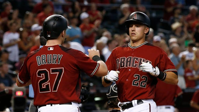 Arizona Diamondbacks' Jake Lamb (22) celebrates his two-run home run against the Chicago White Sox with Brandon Drury (27) during the fifth inning of a baseball game, Wednesday, May 24, 2017, in Phoenix.