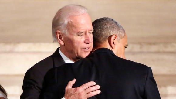 President Barack Obama hugs Vice President Joe Biden
