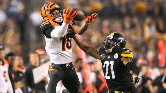 Cincinnati Bengals wide receiver Cody Core (16) is unable to come down with a deep pass as Pittsburgh Steelers cornerback Joe Haden (21) defends in the third quarter during the Week 7 NFL game between the Cincinnati Bengals and the Pittsburgh Steelers, Sunday, Oct. 22, 2017,  at Heinz Field in Pittsburgh.