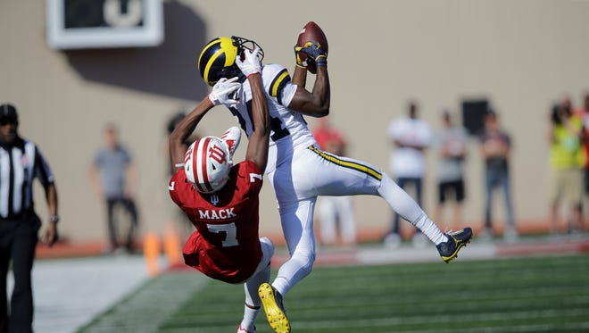 """Michigan defensive back Lavert Hill (24) is seen here in action during the second half of an NCAA college football game between Michigan and Indiana in Bloomington, Ind., Saturday, Oct. 14, 2017. Hill has apologized for an """"offensive gesture"""" he made after the Wolverines' loss to Penn State at Beaver Stadium."""