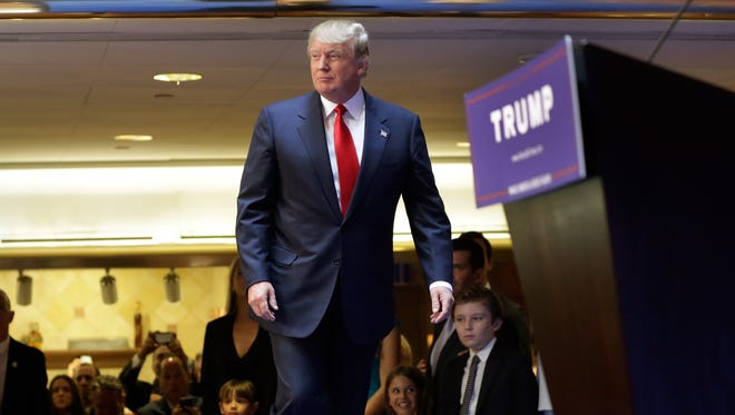 Developer Donald Trump takes the stage to announce that he will seek the Republican nomination for president, Tuesday, June 16, 2015, in the lobby of Trump Tower in New York, Tuesday, June 16, 2015.