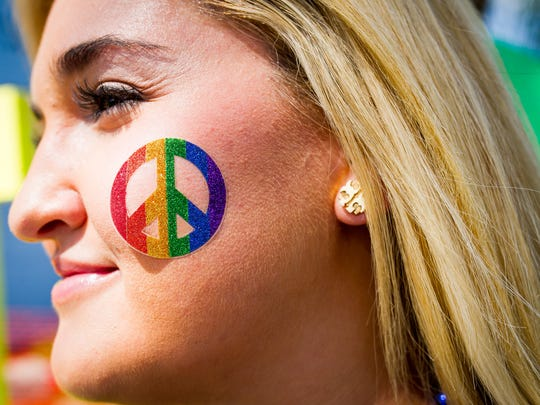 Lauren Zager of Naples sports a rainbow peace sign during the 8th annual SWFL Pride Festival at the Alliance of the Arts in Fort Myers, Florida, on Saturday, Oct 8, 2016. The year's theme highlighted how close the community is coming to the dream of full LGBT equality and liberation.