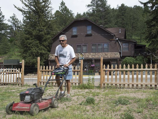 Tony Fink volunteers some of his time to mow the grass outside the Inn of Glen Haven on Friday, June 16, 2017. The bed and breakfast has had help from friends and church groups as its owners seek to reopen this summer.
