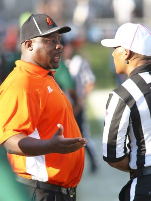 Coach Earl Holmes questions a call against the Rattlers during Saturday's game at Bragg Stadium.