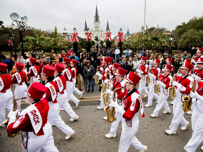 The University of Alabama Marching Band marches in