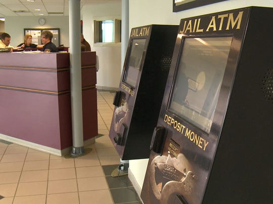 ATMs shown here in a Tennessee jail are similar to machines The Greene County Jail uses to account for money that people bring in when they are booked.