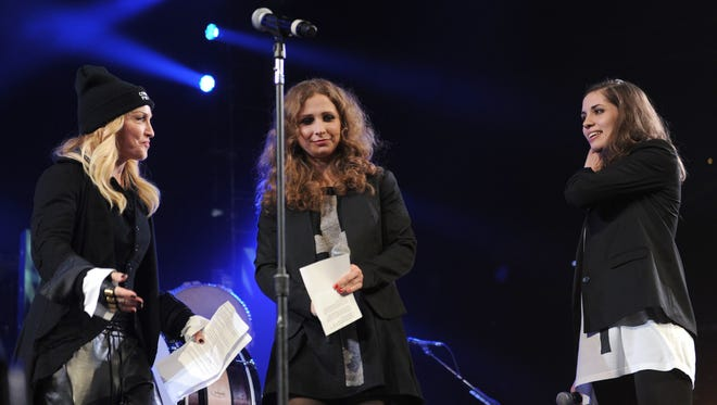 Madonna  introduces Maria Alyokhina and Nadezhda Tolokonnikova of Russian punk protest group Pussy Riot   at the Amnesty International Concert  in New York City.