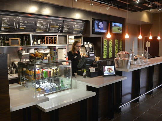 The Courtyard by Marriott includes what it calls the Bistro, a new restaurant that serves sandwiches and Starbucks coffee in the lobby.