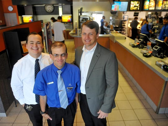 Keith Eakland, center, has worked for McDonald's for thirty years and he will publicly honored by the restaurant at the Voyagers game on August 26. Eakland is flanked by General Manager Joey Himmelberg, left, and Director of Operations Casey Schearer.