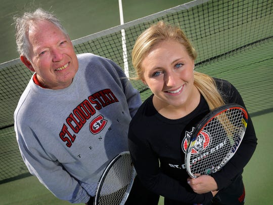 In this St. Cloud Times file photo, then-freshman Alexie Portz poses on the tennis courts with her grandfather and assistant tennis coach Larry Sundby. Portz, now 23, graduated St. Cloud State in 2018 and is a named plaintiff in a Title IX case against the school.