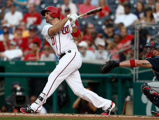 Washington Nationals' Ryan Zimmerman (11) watches his solo home run during the first inning of the team's baseball game against the Atlanta Braves at Nationals Park, Tuesday, June 13, 2017, in Washington. (AP Photo/Carolyn Kaster)