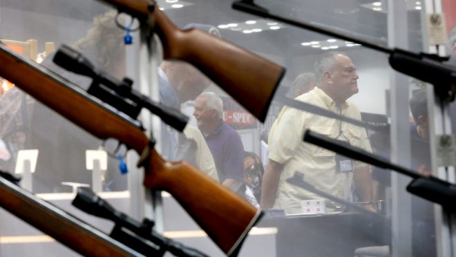 The NRA Convention in downtown Indianapolis in April 2014 included displays of guns.