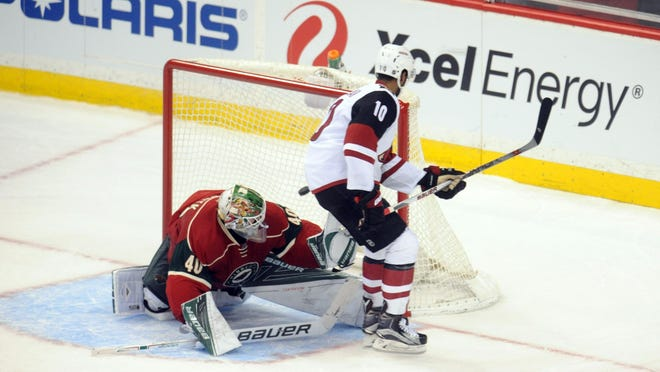 Arizona Coyotes forward Anthony Duclair (10) scores on Minnesota Wild goalie Devan Dubnyk (40) during the shootout Monday at Xcel Energy Center. The Coyotes won 2-1 in an overtime shootout.