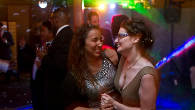 Kristen Dorry of Aberdeen dances with Kaylee Guerra of Sommerset. The third annual Pink Prom features members of the LGBT community out for a night of fun at Hotel Tides.