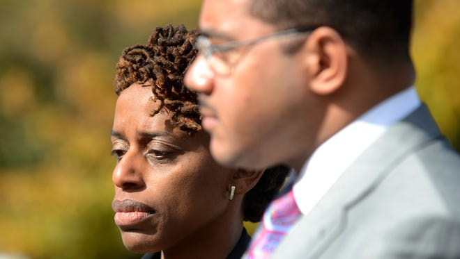 Michelle Curtain, mother of Cinque D'Jahspora, listens to Chris Chestnut, lawyer for the family, during a news conference outside TBI headquarters in Jackson in this November file photo. Police have said that D'Jahspora stabbed a police officer and was then fatally shot by the officer. Chestnut said that D'Jahspora was shot in the back and asked that an outside agency investigate the shooting.