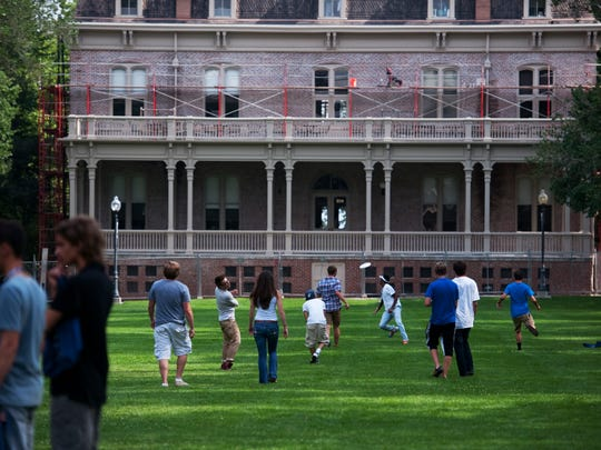 UNR students play frisbee and other games on the quad during their freshman orientation at the UNR campus in the University District in downtown Reno, Nev.