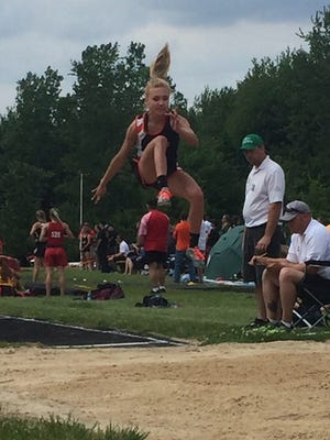 Lucas sophomore Emily Niswander competes in the long jump at the Lancaster regional. She won the meet title, breaking her school record with a leap of 17-0.5.