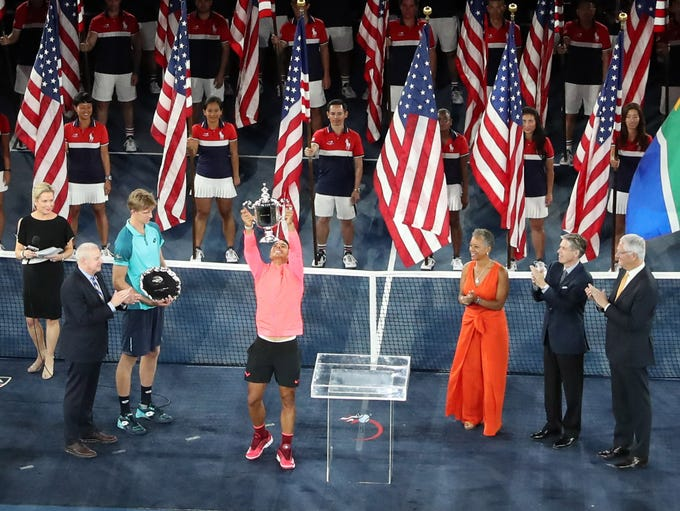 Rafael Nadal, middle, celebrates after beating Kevin