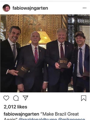 This image posted from Fábio Wajngarten's Instagram account shows, from left, Álvaro Garnero, Vice President Mike Pence, President Donald Trump and Wajngarten, the communications director for Brazil's President Jair Bolsonaro, posing for a photo at Mar-a-Lago in Palm Beach, Florida. Wajngarten tested positive for the new coronavirus, just days after the trip, according to Bolsonaro's communications office on Thursday, March 12, 2020.