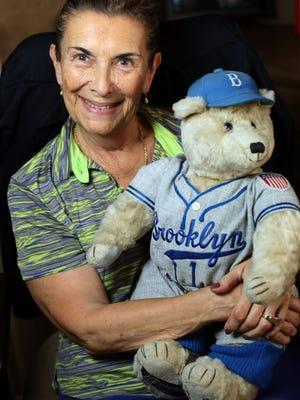 """You don't ever stop being a Dodger fan,"" Palm Desert resident and longtime Dodgers fan Pat Weiss. Among her Dodgers memorabilia is an F.A.O. Schwarz teddy bear wearing a Brooklyn Dodgers uniform."