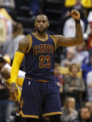 Cleveland Cavaliers forward LeBron James reacts after making a free throw to clinch the win with one second to go against the Indiana Pacers.
