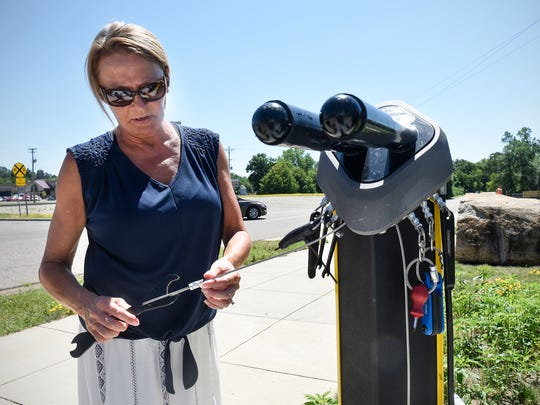 Great River Rotary Club member Alyce Justin looks at