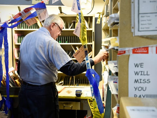 Mail carrier Ray Lund, 79, sorts the mail for his route