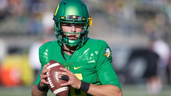 Sep 26, 2015; Eugene, OR, USA; Oregon Ducks quarterback Morgan Mahalak (16) throws the ball before the game against the Utah Utes at Autzen Stadium. Mandatory Credit: Scott Olmos-USA TODAY Sports