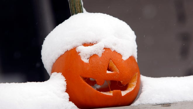 Snow paid a visit to Halloween in Denver in October 2009. Similar scenes are possible Friday in the Great Lakes.
