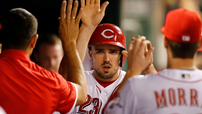 Cincinnati Reds left fielder Adam Duvall (23) is congratulated after scoring in the seventh inning during the MLB game between the Chicago Cubs and Cincinnati Reds, Monday, June 27, 2016, at Great American Ball Park in Cincinnati.
