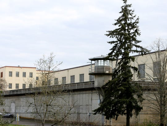 Tall concrete walls with guard towers surround the