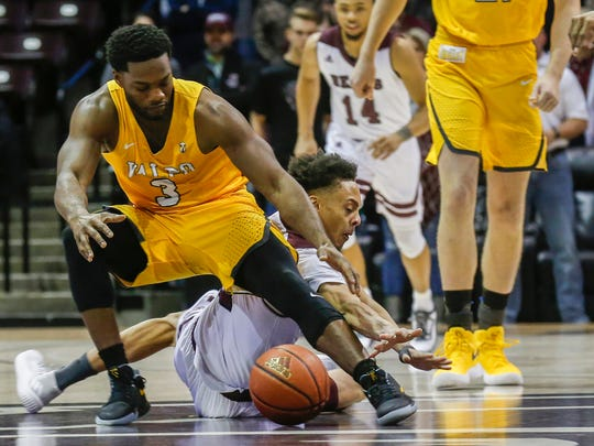 Jarred Dixon, of Missouri State, and Max Joseph, of Valparaiso, go after the loose ball during the Bears game against the Crusaders at JQH Arena on Wednesday, Jan. 17, 2018.
