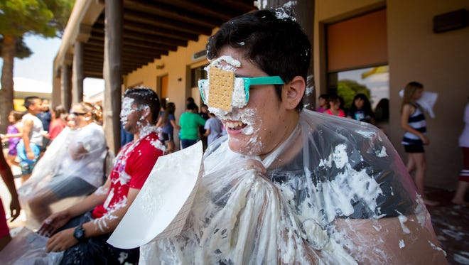 "Central Elementary School music teacher Hannah Lujan gets hit in the face with a ""pie"" made of whipped cream, graham crackers and chocolate as part of the Pennies for Patients fundraiser, April 22, 2016. Central students paid 50 cents each to throw pies at teachers as well as dunk them into a water tank, with the proceeds going to the Leukemia & Lymphoma Society."