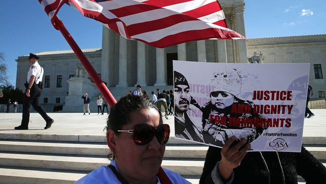Immigration advocates protest in front of the Supreme Court in March.