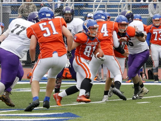 Tyler Lewis carries the ball for Thomas A. Edison during