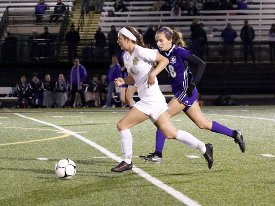 Notre Dame's Jillian Perrault dribbles the ball up the field in front of Little Falls' Geena Morotti on Nov. 3 during a Class C regional final at Corning Memorial Stadium.