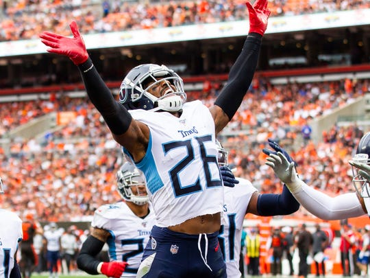 Sep 8, 2019; Cleveland, OH, USA; Tennessee Titans cornerback Logan Ryan (26) celebrates his interception against the Cleveland Browns during the fourth quarter at FirstEnergy Stadium. Mandatory Credit: Scott R. Galvin-USA TODAY Sports